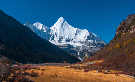 Autumn scenery in Yading Nature Reserve, Daocheng county, Ganzi Tibetan Autonomous Prefecture, Sichuan province of China. The holy peak Yangmaiyong (Jampelyang) can been seen in the background Stok Fotoğraf - 111359317