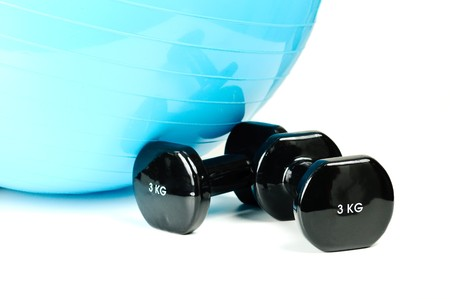 A pilates ball and a couple of dumbbells photo