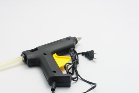 pegamento: Pistola de pegamento con pegamento en barra