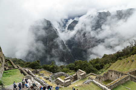 Machu Picchu is s a 15th-century Inca citadel situated on a mountain ridge 2,430 metres (7,970 ft) above sea level. It is located in the Cusco Region, Urubamba Province, Machupicchu District in Peru, above the Sacred Valley, which is 80 kilometres (50 mi)
