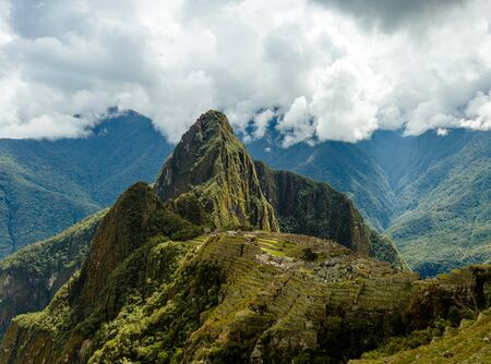 Machu Picchu is s a 15th-century Inca citadel situated on a mountain ridge 2,430 metres (7,970 ft) above sea level. It is located in the Cusco Region, Urubamba Province, Machupicchu District in Peru, above the Sacred Valley, which is 80 kilometres (50 mi) northwest of Cuzco and through which the Urubamba River flows.