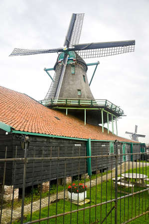Closeup of a windmill in Zaanse Schans near Amsterdam, Holland photo