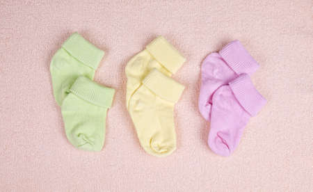 Three pairs of baby socks on a terry towel photo