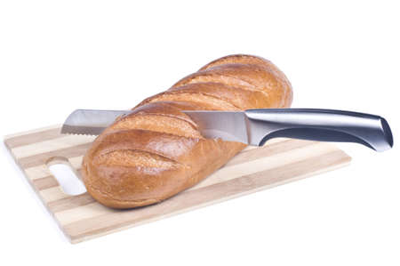 Knife cutting a long loaf isolated over white Stock Photo - 16901732