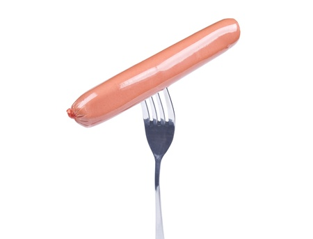Sausage on a fork isolated over white background photo