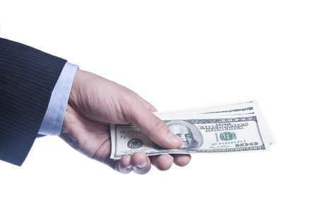 Mans Hand With a Pack Of Dollars Isolated Over White photo