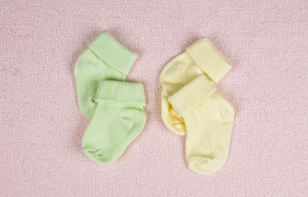 Two pairs of baby socks on a terry towel photo