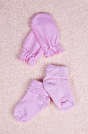 baby socks and mittens on a terry towel photo