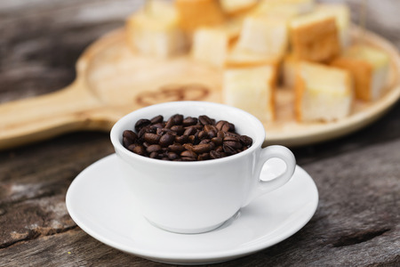 beans on toast: coffee beans on wood background with Toast and butter milk Stock Photo