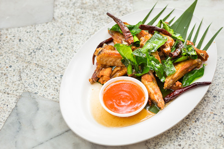 food on table: Fried Chicken with Fish Sauce on marble table