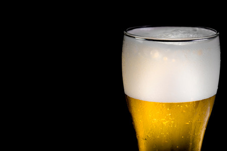 copyspace: Glass beer on black background with copyspace