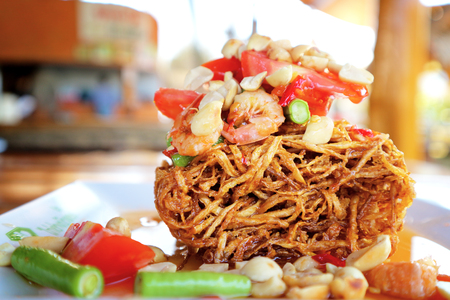 Papaya fried salad Thai fusion food famous and delicious in thailand Somtum