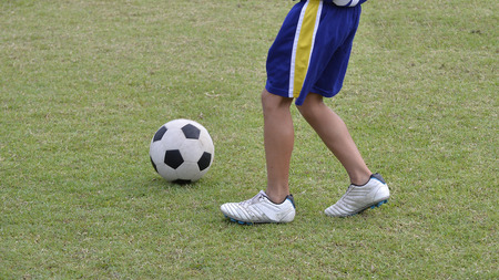 soccer shoes: Soccer shoes & football on the green grass
