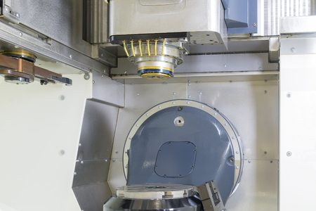 milling center: the five axis computer numerical control or CNC machine with the table and spindle