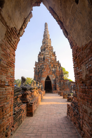 temple tower: the ancient  pagoda in Chai Wattanaram temple in Ayuthaya historical park with the sun set light with the door frame