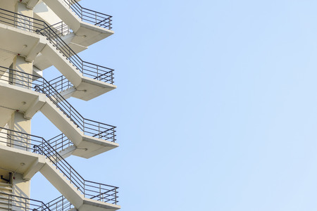 fire escape: the fire escape stair which is a part of building with the sky and cloud
