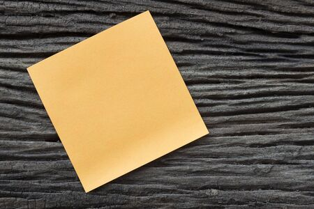 sticky paper: sticky paper note on the old wooden background