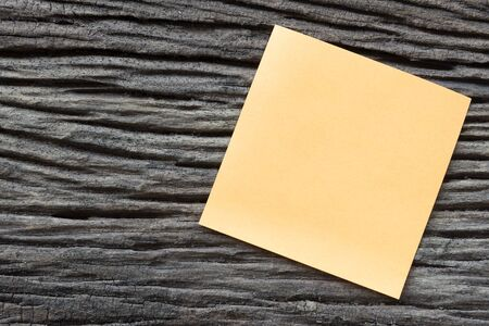note paper: sticky paper note on the old wooden background