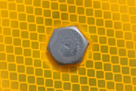 bolt head: close-up of the bolt head on the yellow reflection surface traffic sign