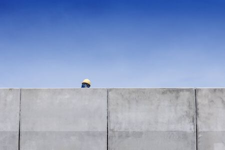 safty: back side of the worker head,back side of the worker hrad with the safty hat in the high way construction site with the blue sky