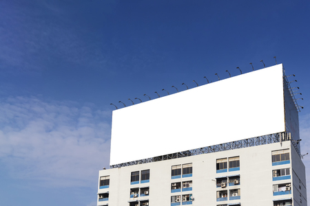 bill board: thewhite background  bill board building on the apatment building with the sky