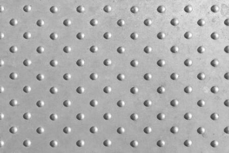 Dot texture,The dot texture in metal plate with the lighting effect.The sphere dot on metal plate with the black and white effect.The small sphere texture on metal plate with black and white tone.