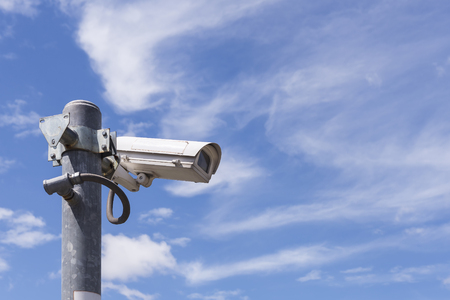 close circuit camera: Close circuit camera,The close circuit camera on the pole with the blue sky background.The security system from the close-circuit camera with the sky.