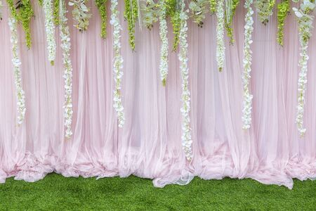 wedding backdrop: Flower backdrop,the backdrop in the wedding ceremony with the grass and flower.The beautiful flower backdrop for ceremony of wedding.