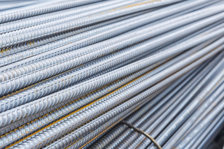 deform: The deform bar, the steel deform bar pile on the construction site. Close-up the corrosion on the steel deform bar which cause of rust. Stock Photo