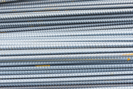 The deform bar, the steel deform bar pile on the construction site. Close-up the corrosion on the steel deform bar which cause of rust. Stock Photo