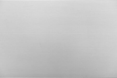 sectional door: The line texture of the white shutter door of the factory building Stock Photo
