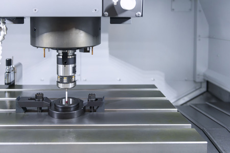 The measurement probe on the CNC machine for calibration.The CNC machine between calibration  in setting process