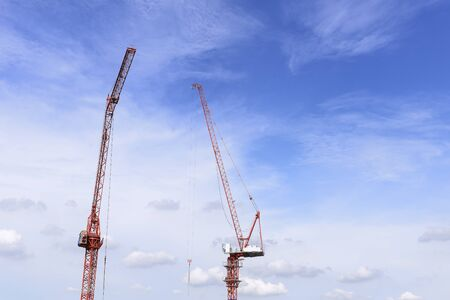 hydraulic lift: The red arm of the construction crane with the blue sky. Stock Photo