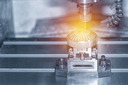 Abstract scene of the CNC milling machine while cutting the sample work piece in blue-silver tone and lighting effect Standard-Bild