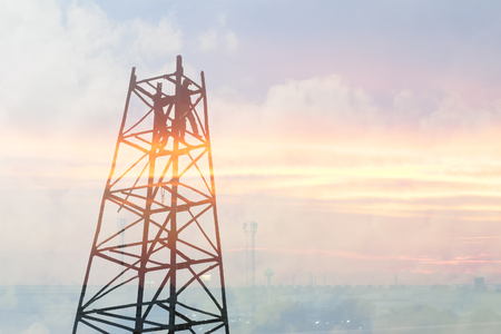 The abstract scene of drop hammer crane structure with the worker on top and the sunset light. Stock Photo
