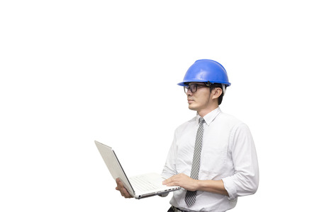 topografo: The isolate scene of engineer hold the laptop by the hand with the white backgroundThe isolate scene of engineer hold the laptop by the hand with the white background Foto de archivo