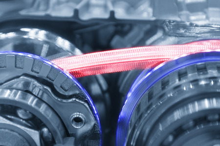 Abstract scene of  steel belt of the automatic transmission gear box  in light-blue tone with glowing edge lighting effect
