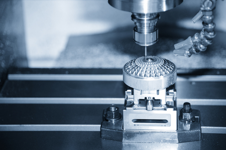 The Hi-precision  CNC milling machine with cutting sample in blue-silver tone. Banco de Imagens
