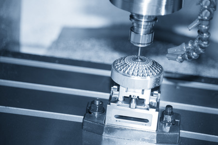 The Hi-precision  CNC milling machine with cutting sample in blue-silver tone. Stock Photo