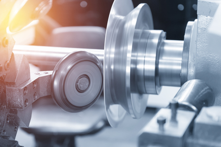 processing speed: The CNC  spinning machine forming the part with lighting effect in light blue scene Stock Photo