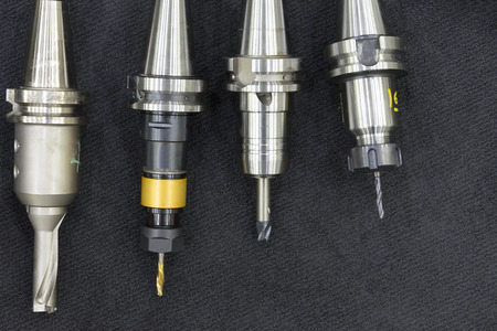carbide: The index-able tool for CNC milling machine on the dark carpet.The various type of cutting tool Stock Photo