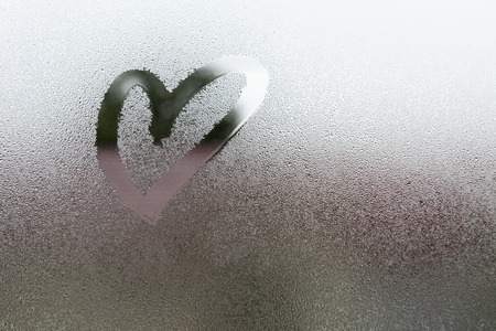 Draw the heart on vapor at the glass