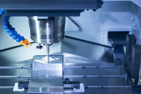 aluminum: The CNC machine cutting work piece.The hi-precision machining process concept.
