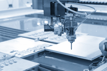 The water jet machine cutting the metal plate .The hi-precision machining concept. Stock Photo