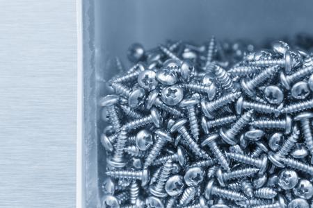 scatter: The cross ball head thread screw   in light blue scene .The pile of screw thread.