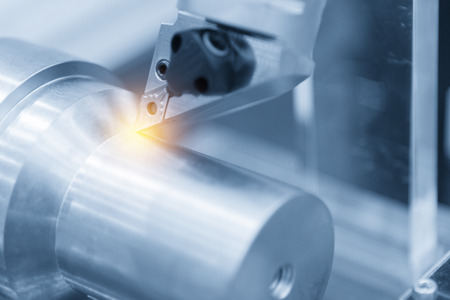CNC lathe machine (Turning machine) while cutting the aluminium screw thread.Hi-precision CNC machining concept.