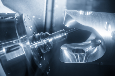 The 5-axis CNC  milling machine  cutting  the automotive part with the ball end-mill tool.Hi-technology machining concept.