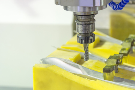 The CNC milling machine cutting the sample jig part with the small end-mill .Hi-precision CNC machining concept.