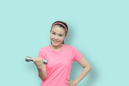 Pretty woman in the fitness class with the light green background.Fitness  beautiful woman concept.