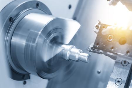 CNC lathe machine (Turning machine) cutting the metal  screw thread part .Hi-precision CNC machining concept. Stock Photo